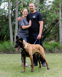 7ee6358afe26 Business owner Jason Arsenault of Arenal K9, a dog training service, poses  with his wife Kim Johnson and his protection dog Bacco on their acreage on  Aug.